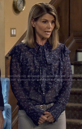 Rebecca's floral ruffled tie neck blouse on Fuller House
