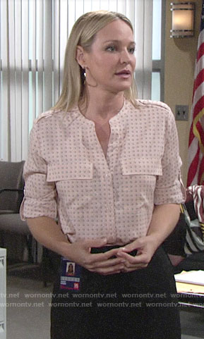 Sharon's pink dotted top on The Young and the Restless