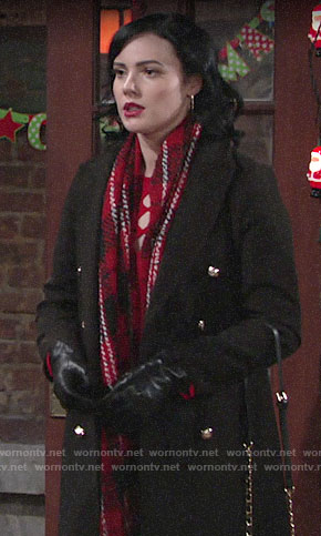 Tessa's black coat and red plaid scarf on The Young and the Restless