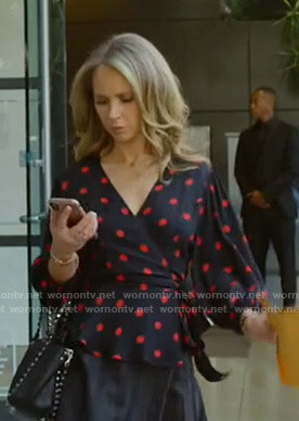 Veronica's black polka dot wrap top on Dirty John