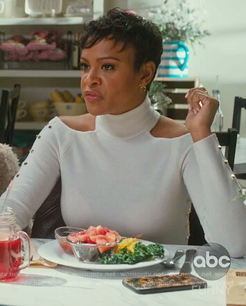 Angela's white studded cold shoulder top on American Housewife
