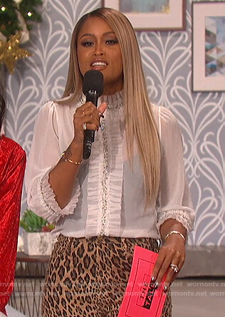 Eve's white embellished ruffle top and leopard pants on The Talk
