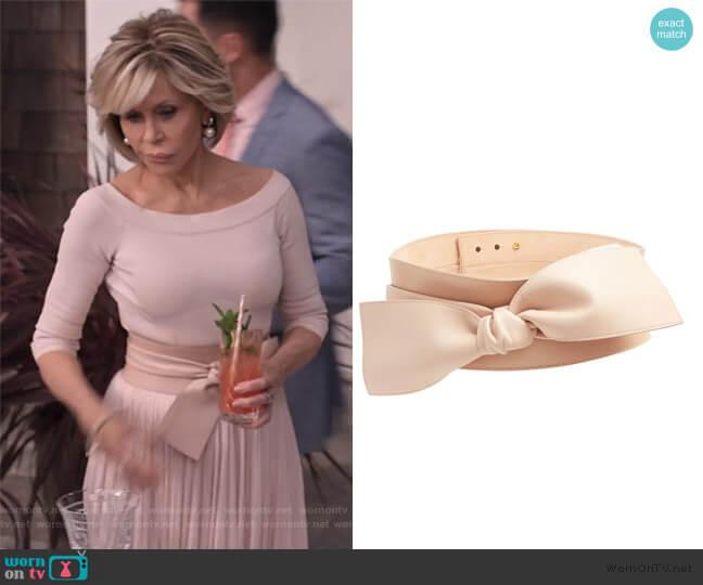 Wide bow-embellished leather waist belt by Alexander McQueen worn by Grace (Jane Fonda) on Grace & Frankie