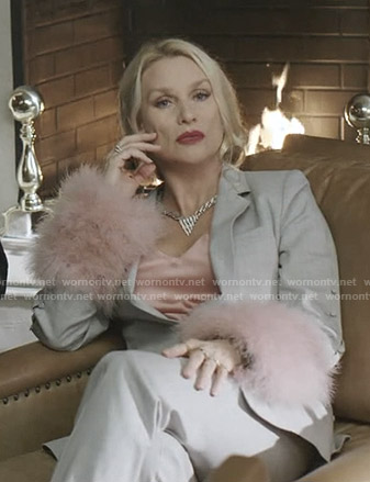 Alexis's grey suit with pink feather cuffs on Dynasty