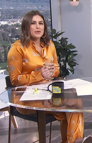 Carissa's orange floral blouse and pants on E! News Daily Pop