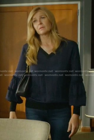 Debra's navy v-neck balloon sleeve top on Dirty John