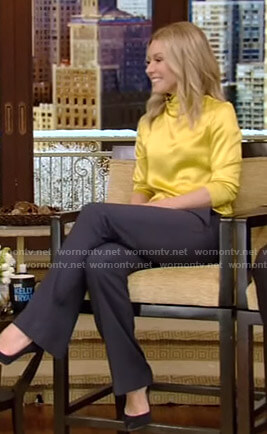 Kelly's yellow satin top and navy pants on Live with Kelly and Ryan