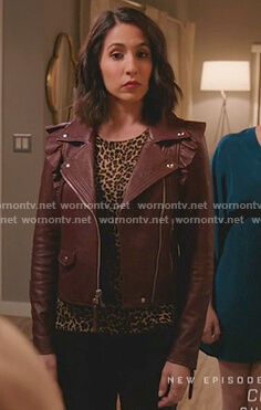 Valencia's burgundy ruffled moto jacket on Crazy Ex-Girlfriend