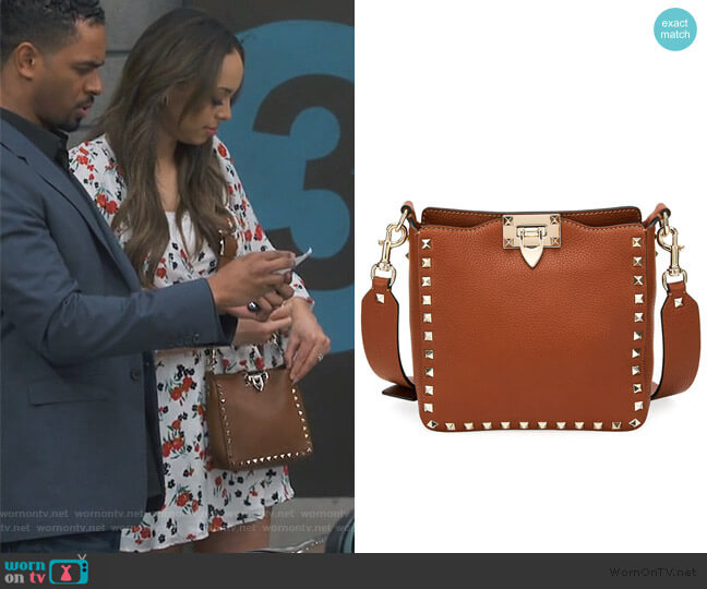 Rockstud Small Vitello Leather Hobo Bag by Valentino  worn by Claire (Amber Stevens West) on Happy Together
