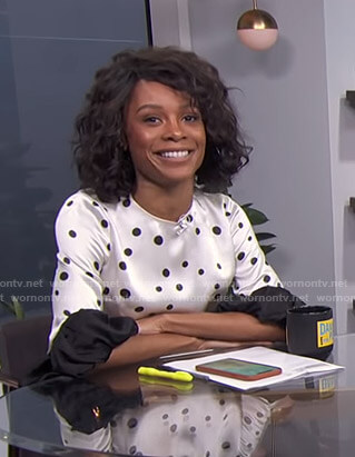 Zuri's white polka dot ruffled sleeve top on E! News Daily Pop
