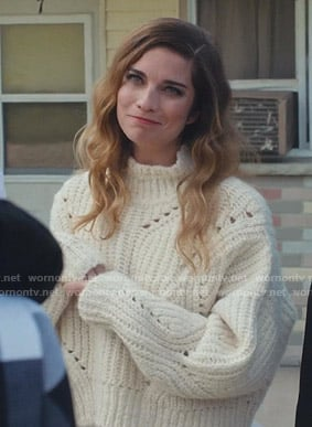 Alexis's white chunky knit sweater on Schitt's Creek