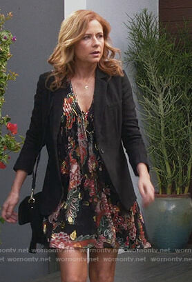 Lena's black floral print mini dress on Splitting Up Together