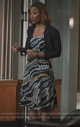 Daisy's black floral print dress on Madam Secretary