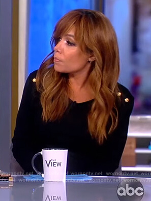 Sunny's black shoulder button sweater and zebra striped skirt on The View