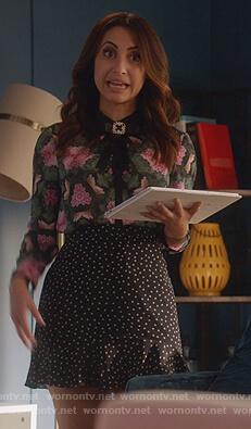 Ana's black star print mini skirt on Grown-ish