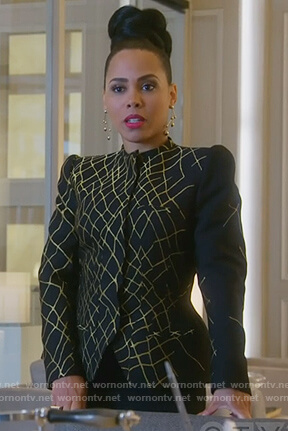 Tegan's black and gold jacket on How to Get Away with Murder