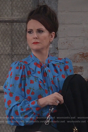 Karen's blue rose print tie neck blouse on Will and Grace