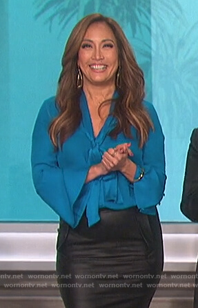 Carrie's teal tie neck blouse on The Talk