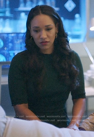 Iris's dark green pleated dress on The Flash