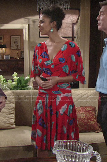 Kerry's red floral dress and green earrings on The Young and the Restless