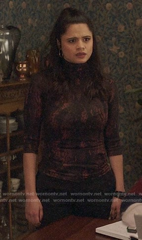 Mel's red and black snake print top on Charmed