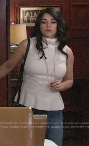Mia's white sleeveless turtleneck top on The Young and the Restless