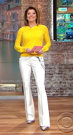 Norah's yellow sweater and white chain detail pants on CBS This Morning