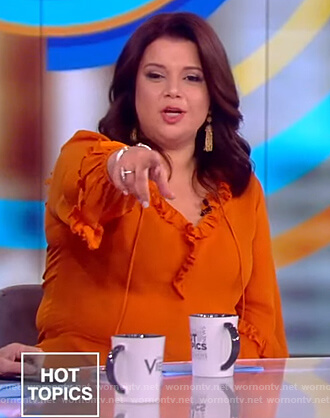 Ana's orange ruffle drawstring blouse on The View