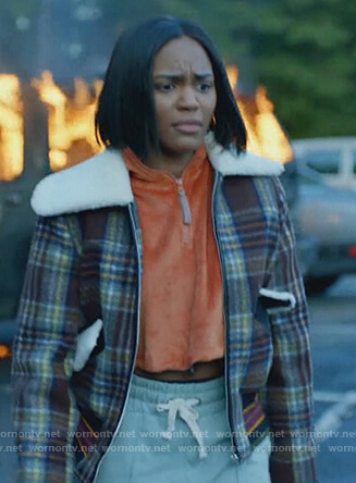 Jennifer's plaid jacket and cropped orange sweater on Black Lightning