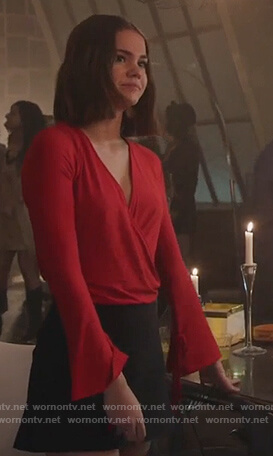 Callie's red wrap top with tie cuffs on Good Trouble
