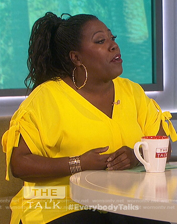 Sheryl's yellow tie sleeve top on The Talk