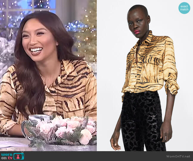 Animal Print Blouse by Zara worn by Jeannie Mai on The Real