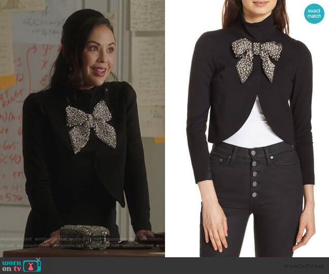 Alice + Olivia Addison Embellished Bow Crop Jacket worn by Mona Vanderwaal (Janel Parrish) on PLL The Perfectionists