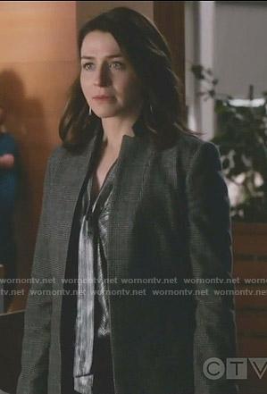 Amelia's metallic tie neck top and checked coat on Grey's Anatomy