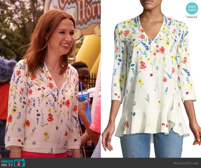 3/4-Sleeve V-Neck Floral-Print Top by Escada worn by Kimmy Schmidt (Ellie Kemper) on Unbreakable Kimmy Schmidt