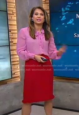 Ginger's pink tie neck blouse and red tweed skirt on Good Morning America