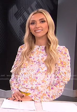 Giuliana's white floral ruffle-sleeve top on E! News