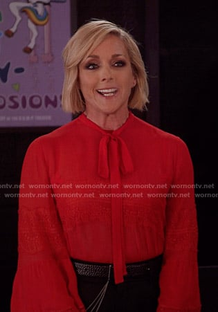 Jacqueline's red tie neck lace-trimmed blouse on Unbreakable Kimmy Schimidt