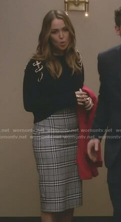 Jo's black safety-pin detail sweater and checked pencil skirt on Grey's Anatomy