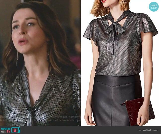 Metallic Striped Tie-Neck Top by Karen Millen worn by Amelia Shepherd (Caterina Scorsone) on Greys Anatomy