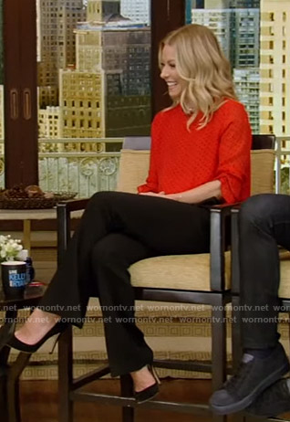 Kelly's red polka dot top and black pants on Live with Kelly and Ryan