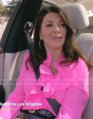 Lisa's pink ruffled blouse on The Real Housewives of Beverly Hills
