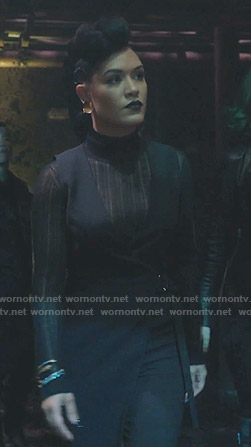 Reeva's black sheer turtleneck sweater on The Gifted
