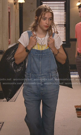 Shannon's white graphic tee and denim overalls on Fam