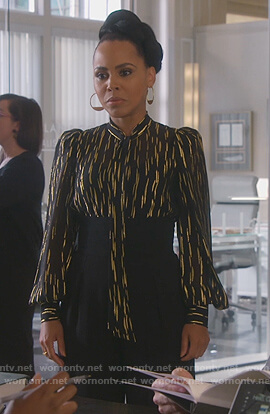 Tegan's black metallic tie neck blouse on How to Get Away with Murder