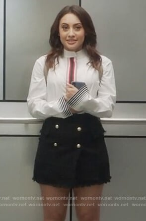 Ana's white stripe blouse and black tweed mini skirt on Grown-ish