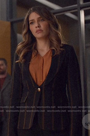 Dinah's black striped blazer on Arrow