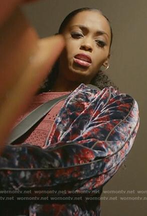 Anissa's velvet bomber jacket and red eyelet fringe top on Black Lightning