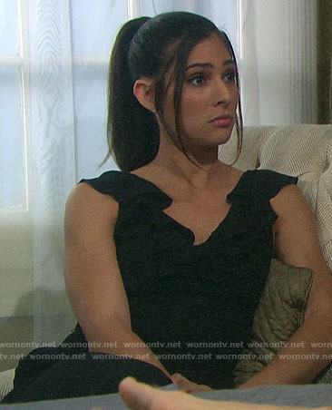 Gabi's black ruffle trim jumpsuit on Days of our Lives