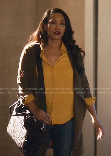 Iris's green draped jacket on The Flash